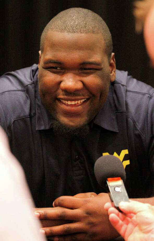 West Virginia offensive lineman Quinton Spain talks to members of the media during a breakout session at the NCAA college Big 12 Conference Football Media Days, Tuesday, July 23, 2013 in Dallas.  (AP Photo/Tim Sharp) Photo: TIM SHARP, Associated Press / FR62992 AP