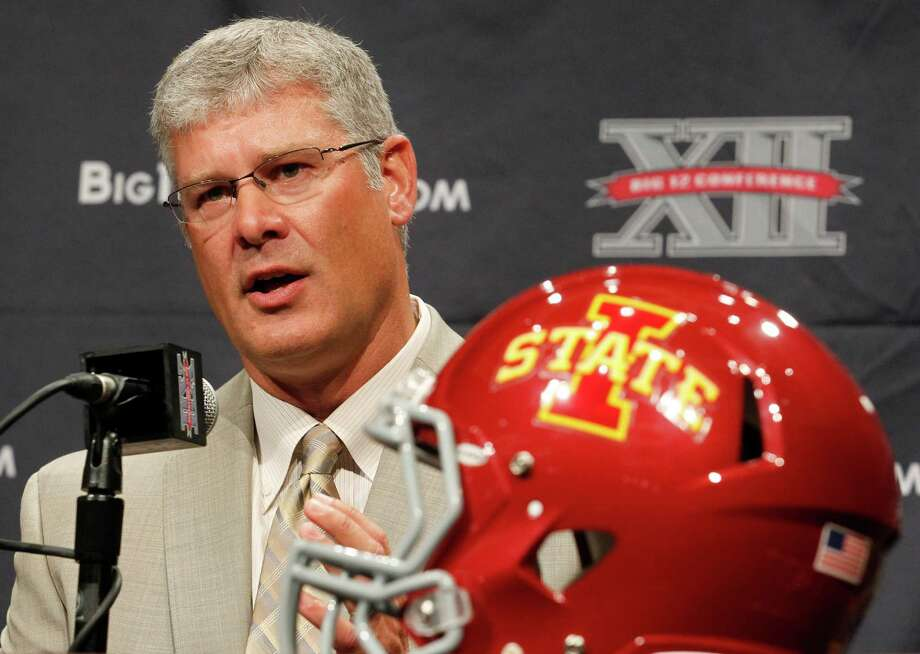 Iowa State football coach Paul Roads addresses the media during the NCAA college Big 12 Conference Football Media Days Monday, July 23, 2013 in Dallas.  (AP Photo/Tim Sharp) Photo: TIM SHARP, Associated Press / FR62992 AP