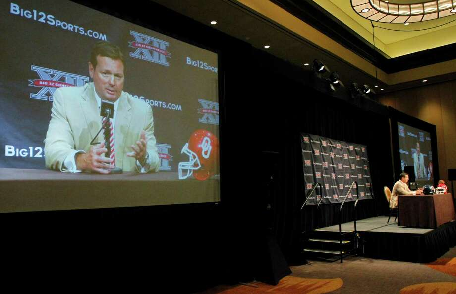 Oklahoma football coach Bob Stoops makes comments about his team during the Big 12 Conference Football Media Days Tuesday, July 23, 2013 in Dallas.  (AP Photo/Tim Sharp) Photo: TIM SHARP, Associated Press / FR62992 AP
