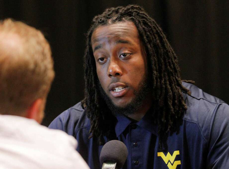 West Virginia defensive lineman Will Clarke talks to members of the media during a breakout session at the Big 12 Conference football Media Days Tuesday, July 23, 2013 in Dallas.  (AP Photo/Tim Sharp) Photo: TIM SHARP, Associated Press / FR62992 AP