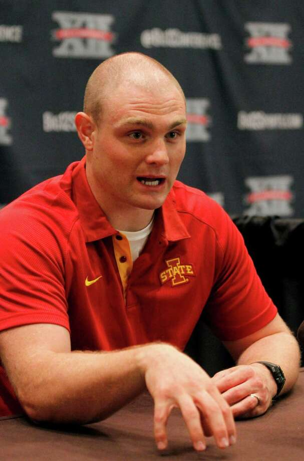 Iowa State running back Jeff Woody talks to members of the media during a breakout session at the NCAA college Big 12 Conference Football Media Days, Tuesday, July 23, 2013 in Dallas.  (AP Photo/Tim Sharp) Photo: TIM SHARP, Associated Press / FR62992 AP