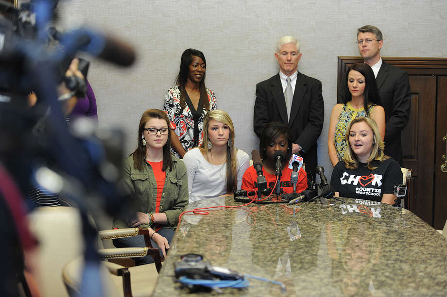 Kountze cheerleaders from left, Savannah Short, Macy Matthews, Kieara Moffett and Rebekah Richardson take questions from local and state media Wednesday at a Beaumont lawfirm. Hardin County's Judge Steve Thomas ruled earlier that day in favor of the girls using religious statements on banners at school functions.  Photo taken Wednesday, May 08, 2013 Guiseppe Barranco/The Enterprise Photo: Guiseppe Barranco, STAFF PHOTOGRAPHER / The Beaumont Enterprise