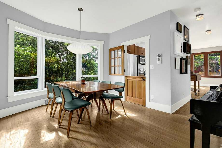 Dining room of 2635 E. Aloha St. It's listed for $788,000. Photo: HD Estates, Courtesy Marcus Holmes, WaLaw Realty