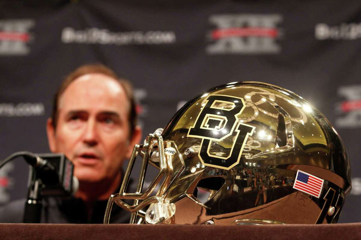 Baylor football coach Art Briles answers questions from the media during the NCAA college Big 12 Conference Football Media Days Tuesday, July 23, 2013 in Dallas. (AP Photo/Tim Sharp)