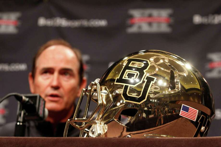 Baylor football coach Art Briles answers questions from the media during the NCAA college Big 12 Conference Football Media Days Tuesday, July 23, 2013 in Dallas.  (AP Photo/Tim Sharp) Photo: TIM SHARP, Associated Press / FR62992 AP