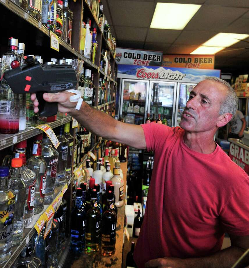 Maurie Samaha has changed the opening time of his store, Danbury Wine & Liquor, from 8 a.m. to 9 a.m., in Danbury, Conn. Tuesday, July 22, 2013. Photo: Michael Duffy / The News-Times