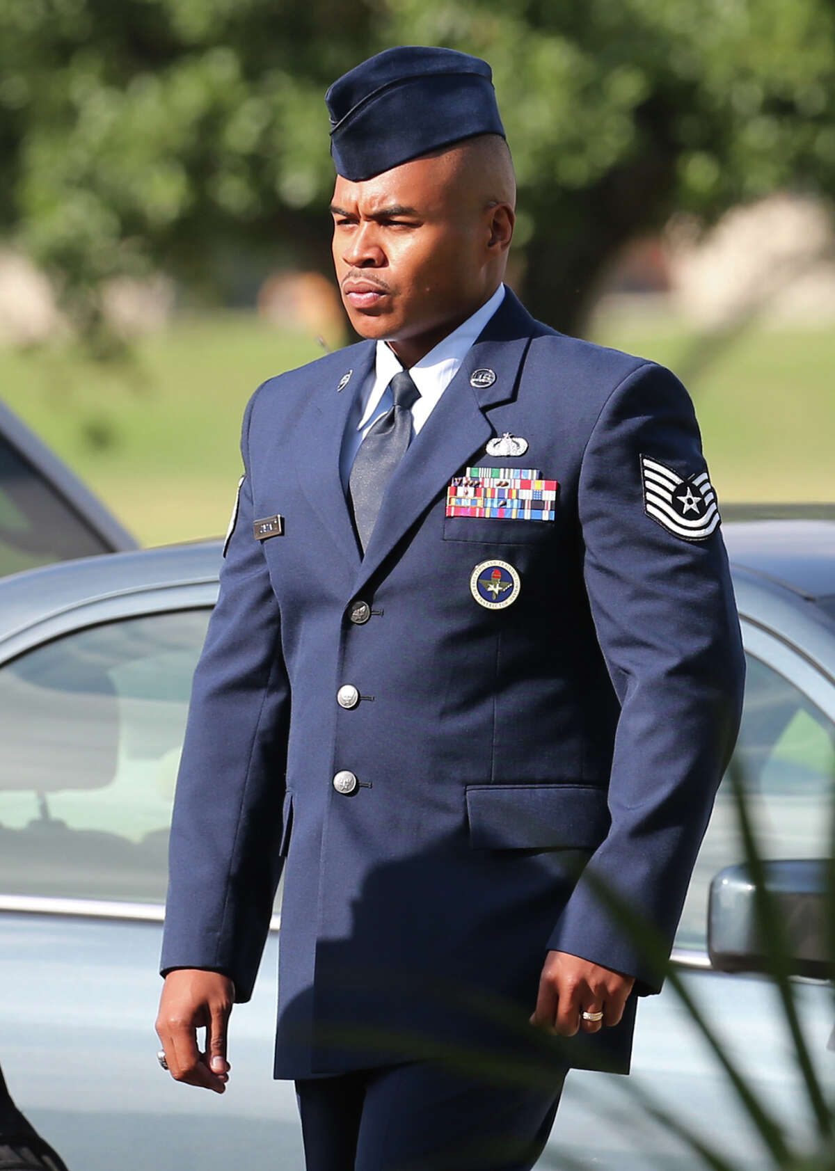 Tech. Sgt. Marc Gayden arrives at Lackland Air Force Base for his trial on sodomy and rape charges, Tuesday, July 23, 2013.