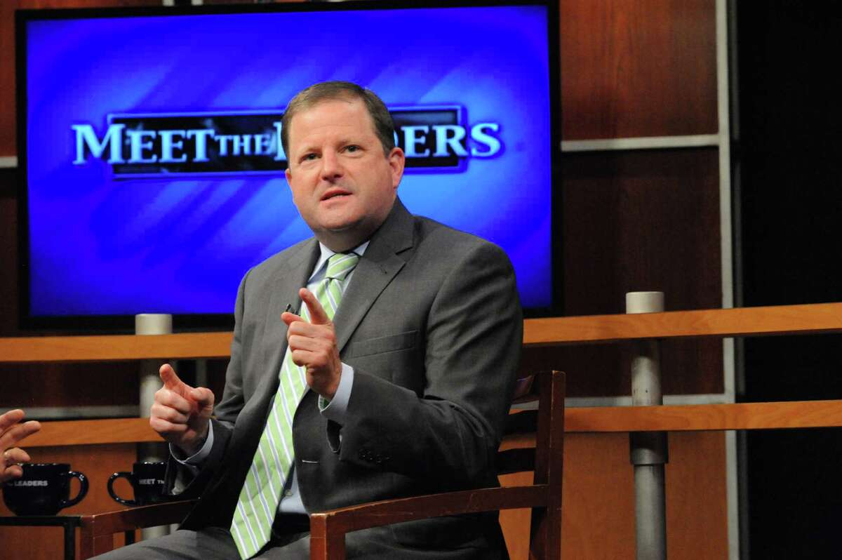 State Senate Minority Leader John McKinney, R-Fairfield, tapes