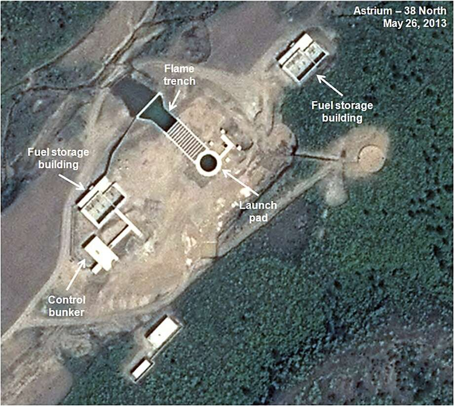 This May 26, 2013 satellite image taken by Astrium, and annotated and distributed by 38 North shows an unfinished new launch pad, center, at the Tonghae facility in North Korea. An eight-month construction standstill at the North Korean site meant to launch bigger and better long-range rockets may signal Pyongyang is slowing or even stopping development of larger rockets, according to a new analysis of recent satellite imagery. (AP Photo/Astrium - 38 North) CREDIT MANDATORY Photo: Associated Press