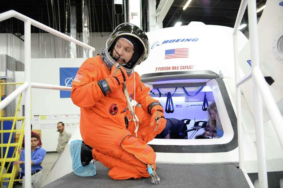 NASA astronaut Randy Bresnik prepares to enter the CST-100 capsule in Boeing's Houston Product Support Center. Photo: ROBERT MARKOWITZ                    , NASA/Robert Markowitz / NASA/JSC - ROBERT MARKOWITZ