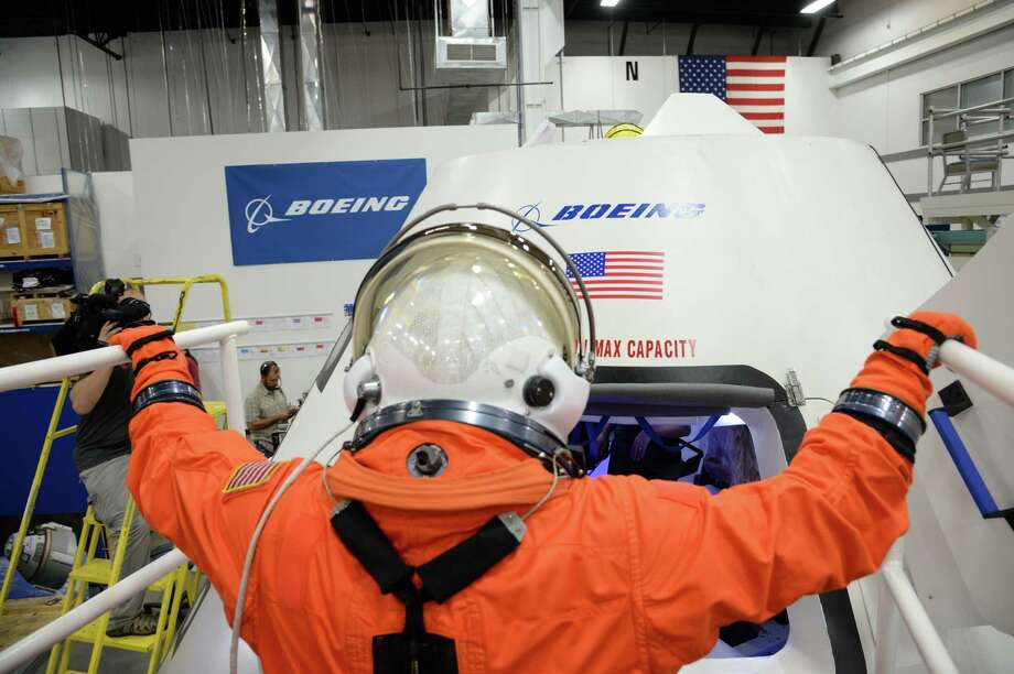 During two, four-hour sessions, astronauts Serena Aunon and Randy Bresnik donned NASA's orange launch-and-entry suits, then tested their maneuverability inside the capsule. Boeing engineers monitored communications, equipment and ergonomics. Here, Aunon enters the CST-100. Photo: NASA/Robert Markowitz