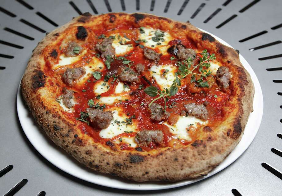 The Sweet Sausage pizza, Pereronata / Sweet Sausage / Fior di Latte / Passata di Pomodoro / Oregano at Pizzeria Solario Thursday, July 18, 2013, in Houston. ( James Nielsen / Houston Chronicle ) Photo: James Nielsen, Staff / © 2013  Houston Chronicle