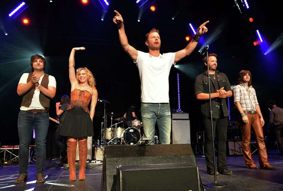 Dierks Bentley &  Friends, Neil Perry, Kimberly Perry both of The Band Perry Dierks Bentley, Randy Houser and Reid Perry of the Band Perry sell out Country Cares Concert raising over $400,000.00 To Benefit the families of The Granite Mountain Hot Shots at Tim's Toyota Center on July 22, 2013 in Prescott, Arizona. Photo: Rick Diamond, Getty Images / 2013 Getty Images