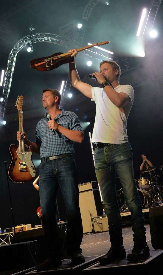 GAC's Storme Warren with Dierks Bentley auction 2 Fender guitars for $50,000.00 during the sold out Country Cares Concert raising over $400,000.00 To Benefit the families of The Granite Mountain Hot Shots at Tim's Toyota Center on July 22, 2013 in Prescott, Arizona. Photo: Rick Diamond, Getty Images / 2013 Getty Images