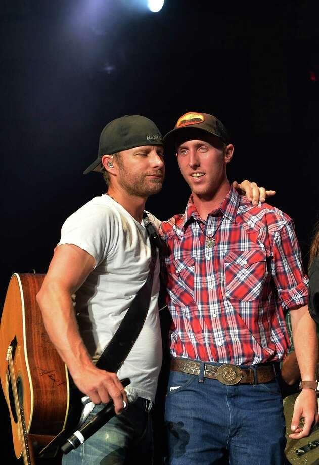 Dierks Bentley and  Brendan McDonough lone survivor of Prescott Az. fires attends Country Cares Concert raising over $400,000.00 To Benefit the families of The Granite Mountain Hot Shots at Tim's Toyota Center on July 22, 2013 in Prescott, Arizona. Photo: Rick Diamond, Getty Images / 2013 Getty Images