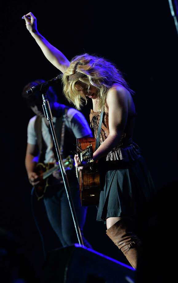 Kimberly Perry of The Band Perry performs as Dierks Bentley & Friends comes home and sell out The Country Cares Concert raising over $400,000.00 To Benefit the families of The Granite Mountain Hot Shots at Tim's Toyota Center on July 22, 2013 in Prescott, Arizona. Photo: Rick Diamond, Getty Images / 2013 Getty Images