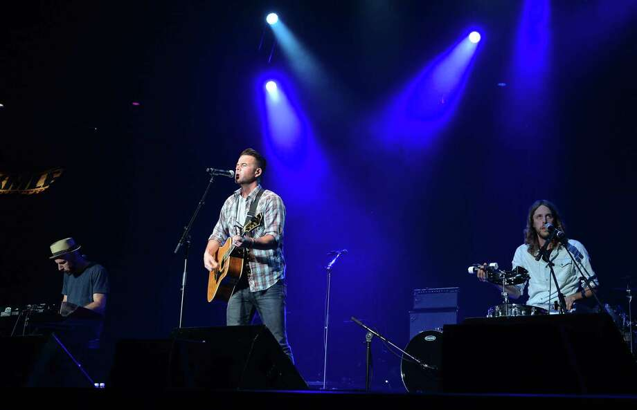 David Nail (center) performs as Dierks Bentley & Friends comes home and sell out The Country Cares Concert raising over $400,000.00 To Benefit the families of The Granite Mountain Hot Shots at Tim's Toyota Center on July 22, 2013 in Prescott, Arizona. Photo: Rick Diamond, Getty Images / 2013 Getty Images