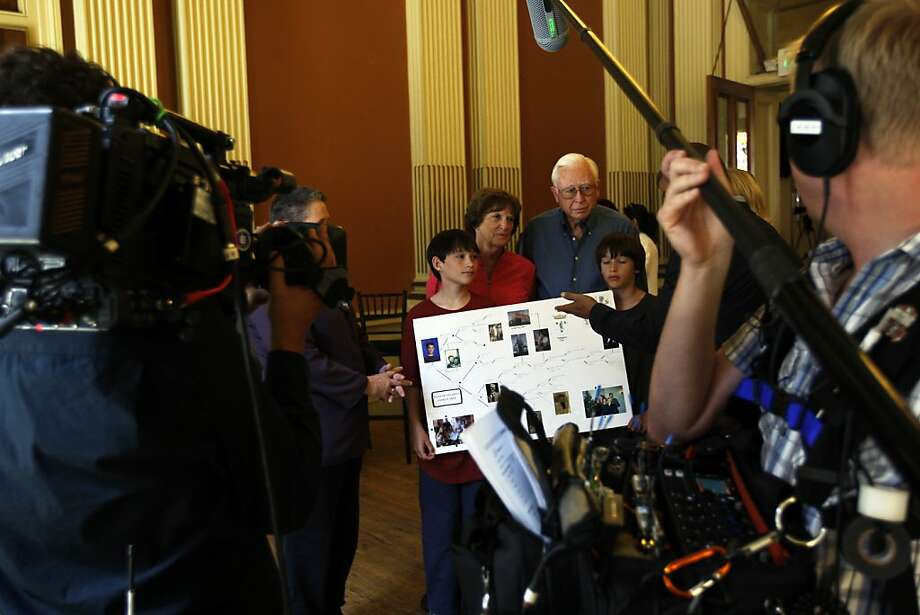 "The Stannard family holds a diagram of their family tree on the set of ""Genealogy Roadshow,"" to air on PBS in September. Photo: Rohan Smith, The Chronicle"