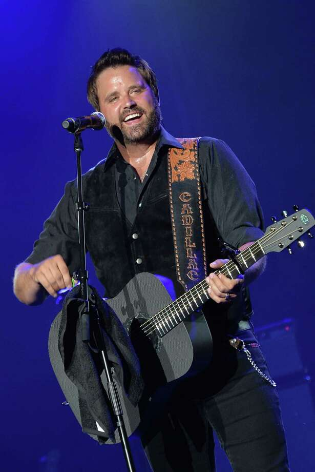 Randy Houser performs as part of Dierks Bentley & Friends comes home and sell out The Country Cares Concert raising over $400,000.00 To Benefit the families of The Granite Mountain Hot Shots at Tim's Toyota Center on July 22, 2013 in Prescott, Arizona. Photo: Rick Diamond, Getty Images / 2013 Getty Images