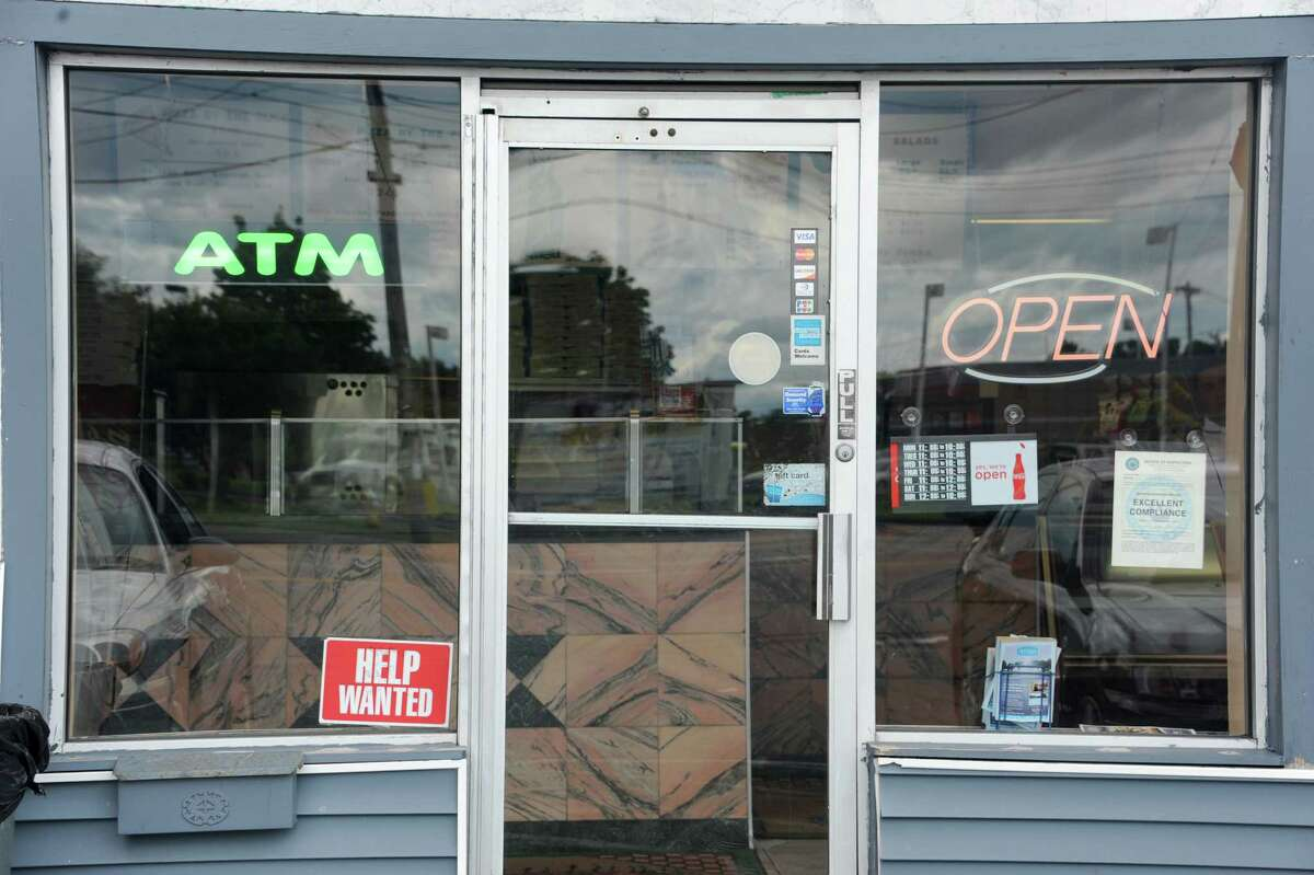 A help wanted sign is posted in the window of an I Love NY Pizza Tuesday afternoon, July 23, 2013, in Colonie, N.Y. (Lori Van Buren / Times Union)