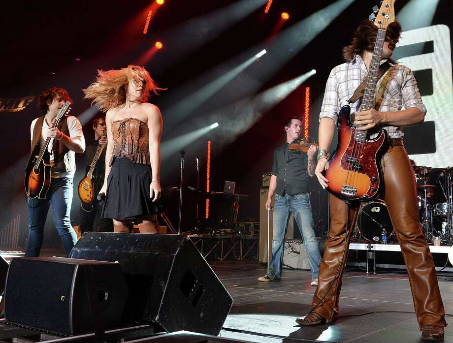 The Band Perry perform as part of Dierks Bentley & Friends sold out Country Cares Concert raising over $400,000.00 To Benefit the families of The Granite Mountain Hot Shots at Tim's Toyota Center on July 22, 2013 in Prescott, Arizona. Photo: Rick Diamond, Getty Images / 2013 Getty Images