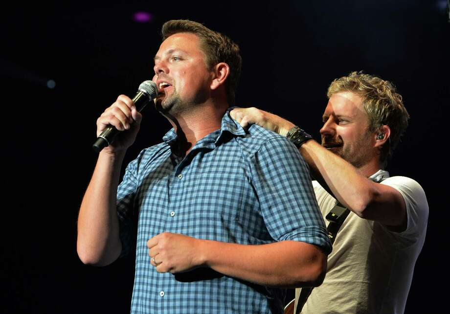 GAC's Storme Warren  with Dierks Bentley during the sold out Country Cares Concert raising over $400,000.00 To Benefit the families of The Granite Mountain Hot Shots at Tim's Toyota Center on July 22, 2013 in Prescott, Arizona. Photo: Rick Diamond, Getty Images / 2013 Getty Images