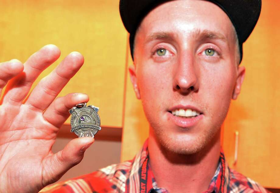 Brendan McDonough (lone survivor of Prescott Az. fires) displays to me the HOT SHOTS memorial medal during  Country Cares Concert raising over $400,000.00 To Benefit the families of The Granite Mountain Hot Shots at Tim's Toyota Center on July 22, 2013 in Prescott, Arizona. Photo: Rick Diamond, Getty Images / 2013 Getty Images