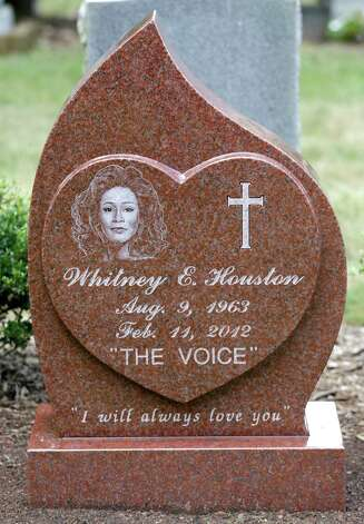 This Tuesday July 23, 2013 photo shows the new headstone at the grave of singer Whitney Houston, at Fairview Cemetery in Westfield, N.J., about 20 miles west of New York. The 48-year-old pop music queen died Feb. 11, 2012, in Beverly Hills, Calif. An autopsy found she had drowned accidentally, with heart disease and cocaine use contributing to her death. She is buried next to her father. Photo: Julio Cortez