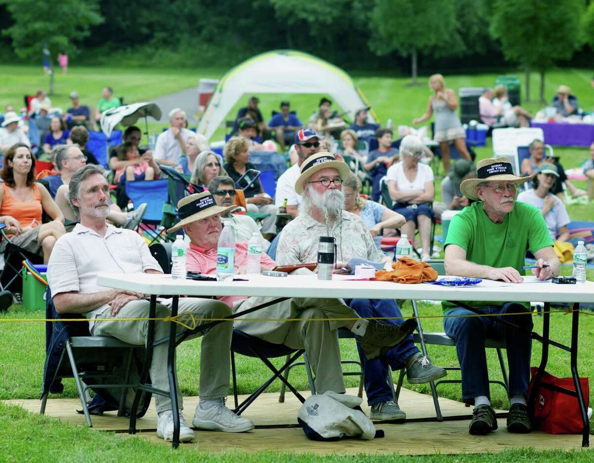 A quartet of judges, from left to right, Chris Teske, Brian Lillie, Glen Burley and Gerald Devokaitis, settles in to listen to dozens of performers during the 39th annual Roxbury Pickin'n Fiddlin' contest July 13 at Hurlburt Community Park along West Apple Lane in Roxbury.