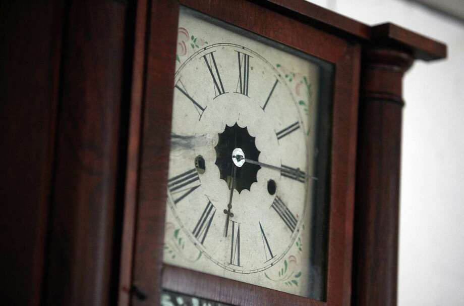 The clock marks the time of Sam Houston's death near the spot where he passed away in the Steamboat House. Photo: Mayra Beltran / © 2013 Houston Chronicle