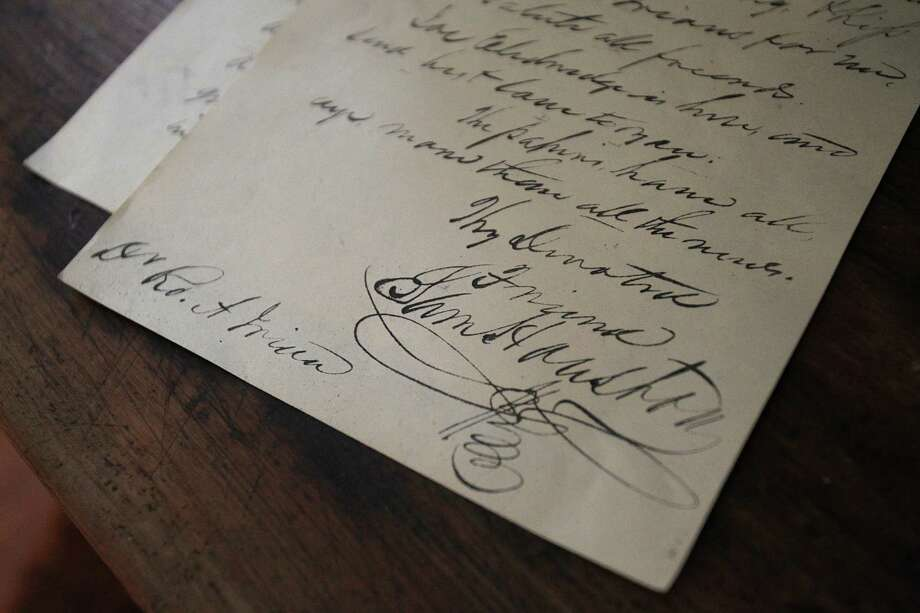Sam Houston's signature on a letter sits in the room where he passed away in the Steamboat House. Photo: Mayra Beltran / © 2013 Houston Chronicle
