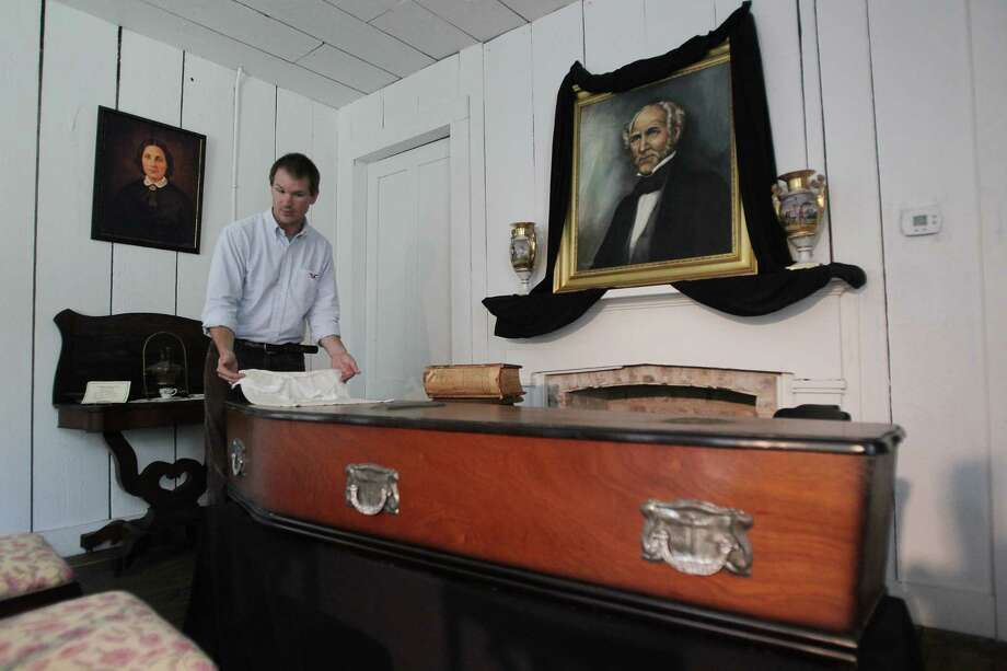 Michael Sproat, Curator of Education at the Sam Houston Memorial Museum, stands in the funeral parlor where Sam Houston's funeral occurred in the Steamboat House. Photo: Mayra Beltran / © 2013 Houston Chronicle