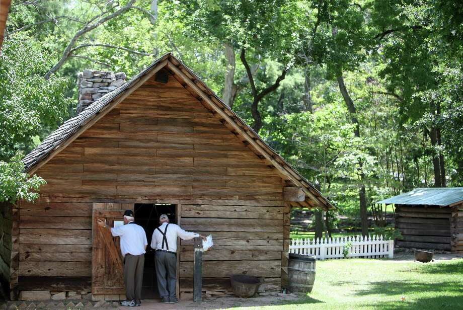 Visitors view a replica of Sam Houston's kitchen next to his home named 'Woodland Home'. Photo: Mayra Beltran / © 2013 Houston Chronicle