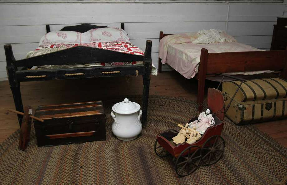 A rope bed frame and childrens toys sit in Sam Houston's daughters room in his home named 'Woodland Home'. Photo: Mayra Beltran / © 2013 Houston Chronicle