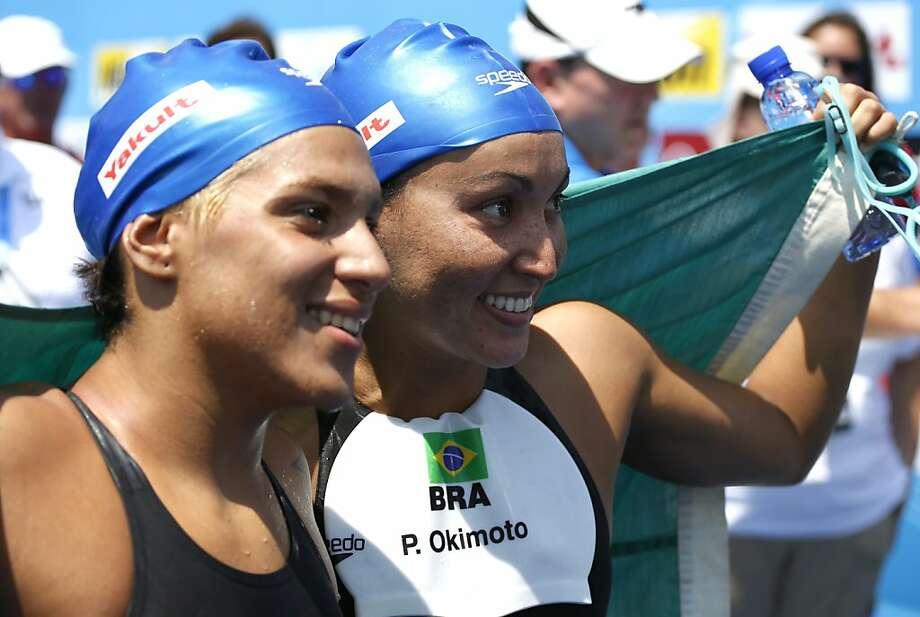 Poliana Okimoto (right) beat fellow Brazilian Ana Marcela Cunha by a mere 0.3 seconds. Photo: Emilio Morenatti, Associated Press