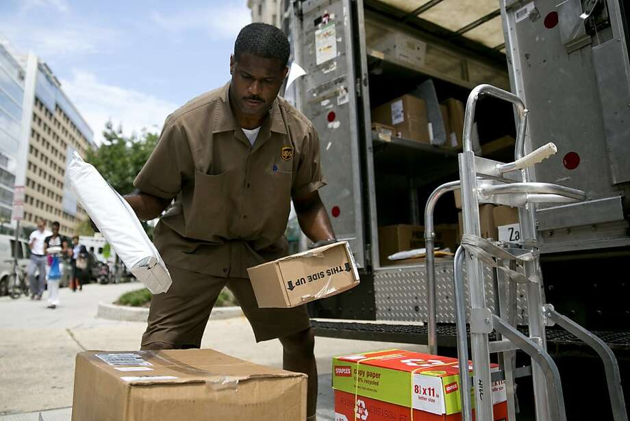As customers avoid sending pricier overnight packages, UPS is cutting back on miles driven and flight hours as well as discretionary spending. Photo: Andrew Harrer, Bloomberg