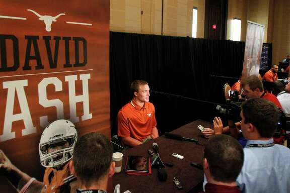 Texas quarterback David Ash talks to members of the media during a breakout session at the Big 12 Conference football media days Tuesday, July 23, 2013, in Dallas.  (AP Photo/Tim Sharp)