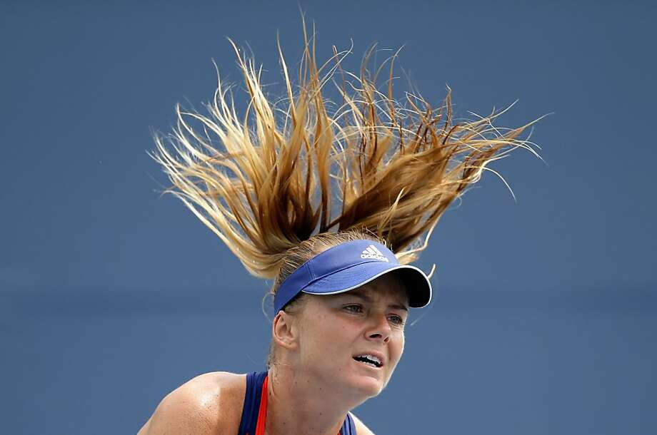 With hair flying, Daniela Hantuchova beats Yanina Wickmayer 6-2, 4-6, 6-0 in the first round. Photo: Ezra Shaw, Getty Images