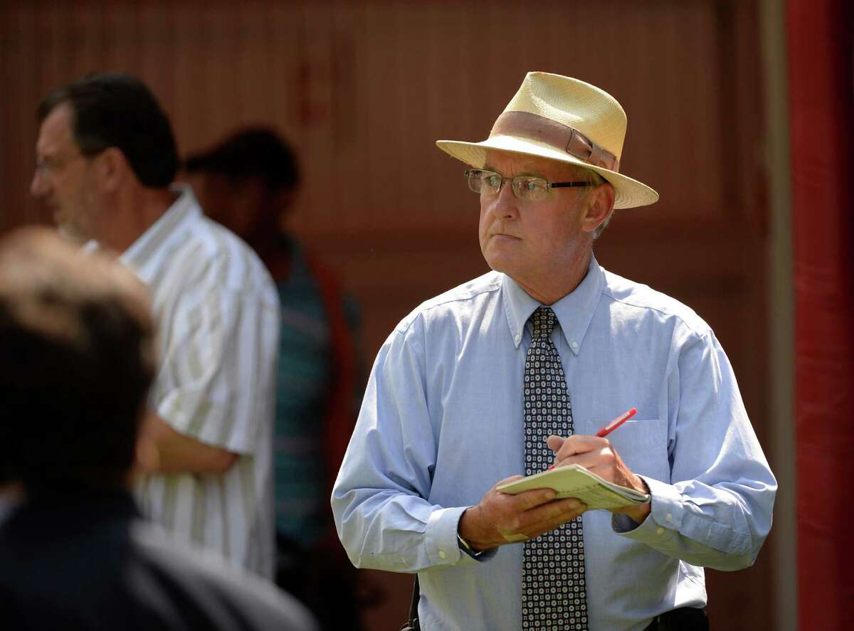 Pddock & patrol judge Peter T. FitzGerald watches every move made by patrons and horses in the paddock at Saratoga Race Course Monday, July, 22, 2013, in Saratoga Springs, N.Y. (Skip Dickstein/Times Union)