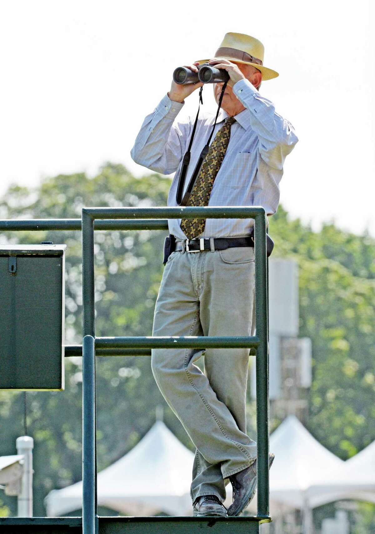 Pddock & patrol judge Peter T. FitzGerald watches a race from his judges stand at Saratoga Race Course Monday, July, 22, 2013, in Saratoga Springs, N.Y. (Skip Dickstein/Times Union)