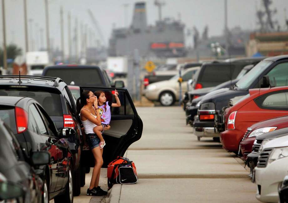 Alyssa Gutierrez holds her daughter Araceli, from San Antonio, as she sees off her husband Petty Officer 3rd Class Andres Gutierrez as he deploys on the Harry S. Truman from Norfolk Naval Station, Va., for a nine-month cruise to the Persian Gulf on Monday, July 22, 2013. Photo: Stephen M. Katz, Associated Press / The Virginian-Pilot
