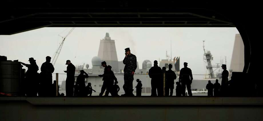Sailors gather on the hanger deck as they and others assigned to the Harry S. Truman deploy from Norfolk Naval Station, Va., for a nine-month cruise to the Persian Gulf on Monday, July 22, 2013. Photo: Stephen M. Katz, Associated Press / The Virginian-Pilot