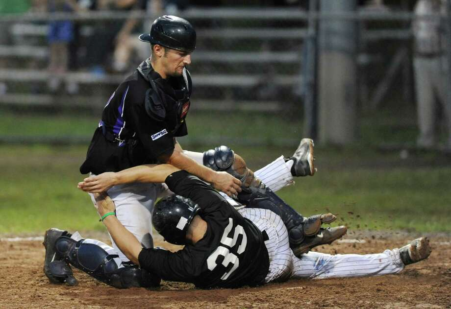 Danbury's Jonathan Testani slides safely into home as Keene catcher Tommy Monnot attempts to tag him out during the Danbury Westerners NECBL baseball game against the Keene Swamp Bats at Rogers Park in Danbury, Conn. on Tuesday, July 23, 2013. Photo: Tyler Sizemore / The News-Times