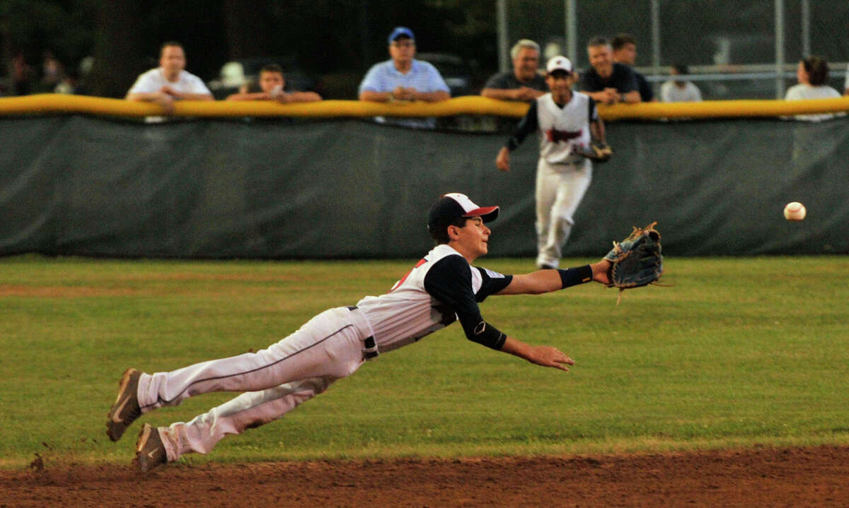 Westport shortstop Ricky Offenberg dives unsuccessfully for a ball hit up the middle during their Section 1 Little League Championship game against Edgewood at Scalzi Park in Stamford on Tuesday, July 23, 2013.