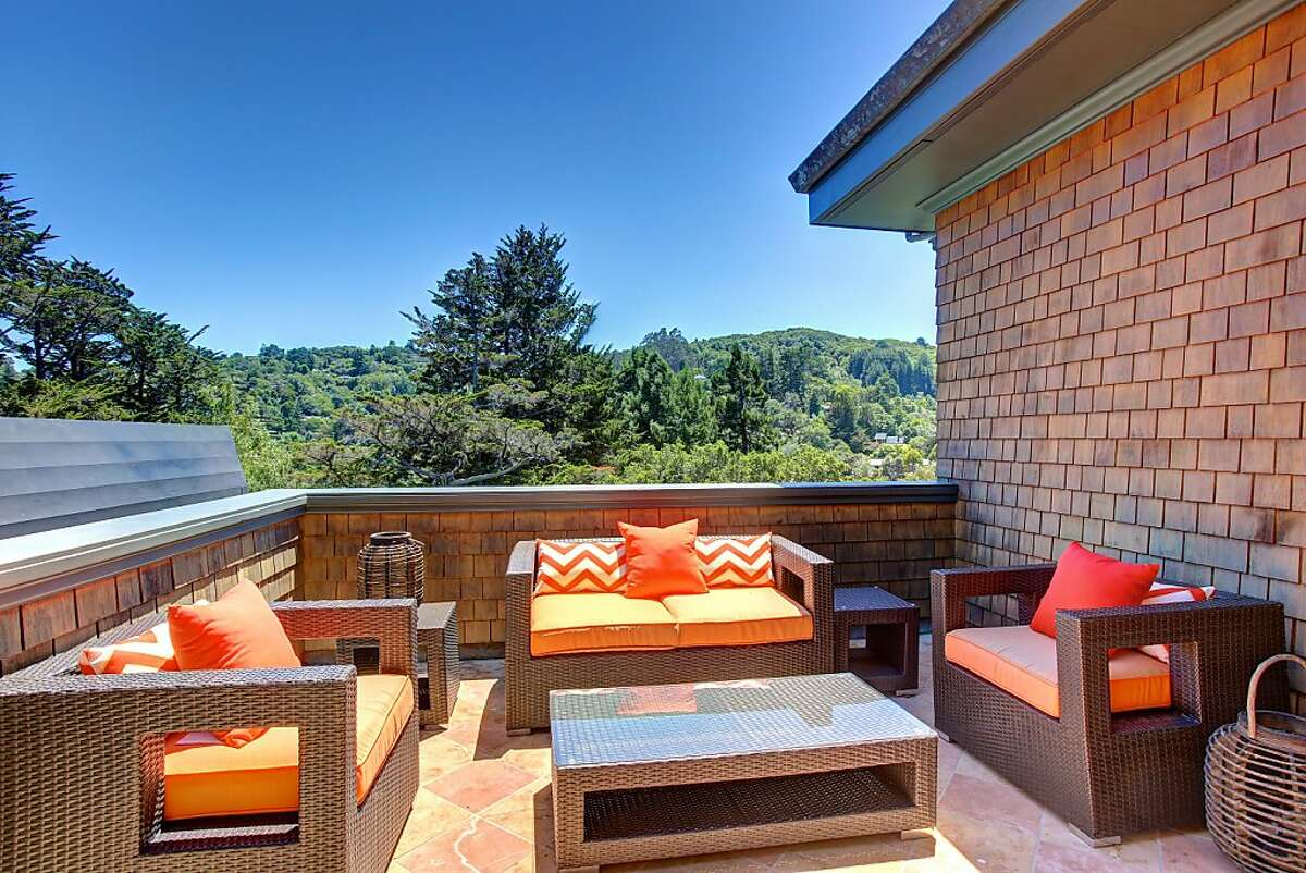 The terrace off the master suite looks out at the lush hillsides surrounding the Mill Valley home.