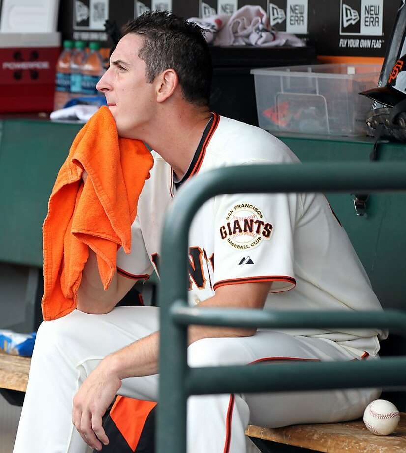 Eric Surkamp watches from the dugout after being tagged. Photo: Lance Iversen, The Chronicle