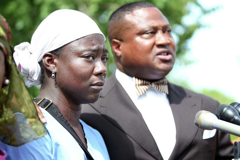 Shanequia McDonald, shown with activist Quanell X during a news conference on Tuesday, says she felt threatened by a man carrying a knife and sexually harassing her. Photo: Mayra Beltran, Houston Chronicle / © 2013 Houston Chronicle