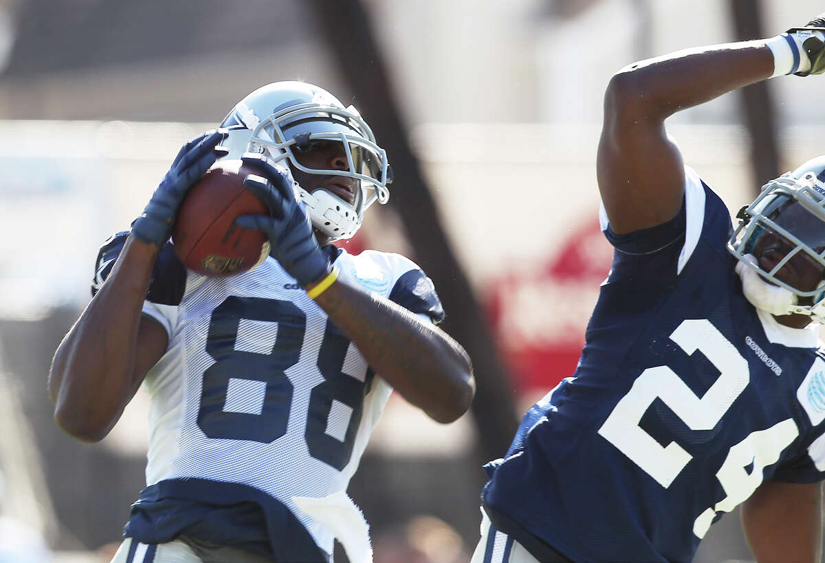 Receiver Dez Bryant (88) makes a catch against cornerback Morris Claiborne (24) during the afternoon session of the 2013 Dallas Cowboys training camp on Tuesday, July 23, 2013 in Oxnard.