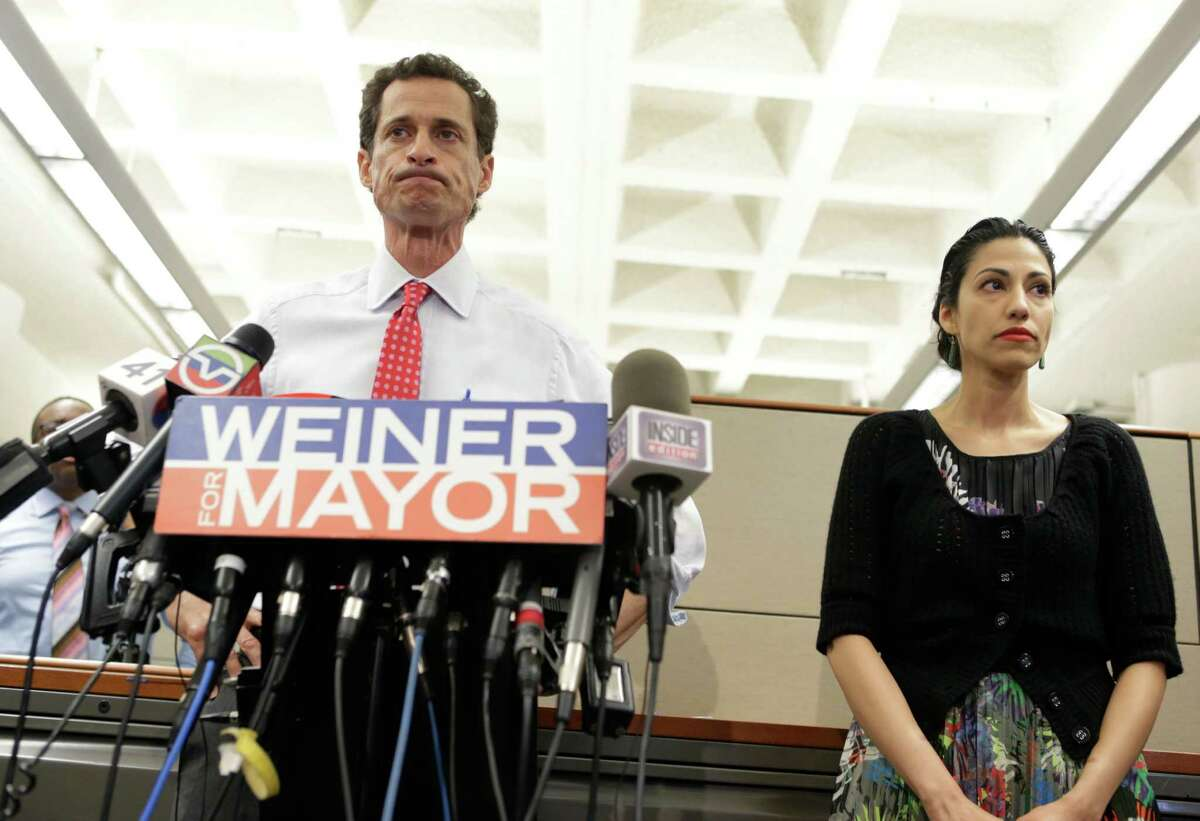 New York City mayoral Anthony Weiner stands beside his wife Huma Abedin as he addresses the press about allegations of sexual text messages that continued after he resigned, prior to an appearance at the Gay Men's Health Crisis offices, Tuesday, July 23, 2013, in New York. Weiner admitted to sending more text messages after his resignation, but said he plans to continue his run for mayor. (AP Photo/Kathy Willens) ORG XMIT: NYKW101