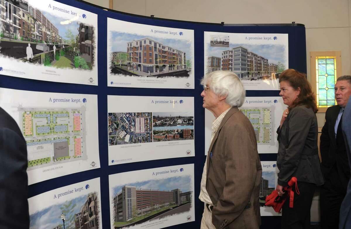 People look at a board dispalying renderings of the residential redevelopment of Park South Tuesday, July 23, 2013, at Albany Medical Center in Albany, N.Y. (Lori Van Buren / Times Union)